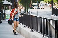 Kelly Halpin makes her way through the Sugar House neighborhood of Salt Lake City, Utah.