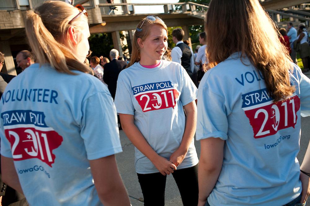 Volunteers for the Iowa Straw Poll wait outside the Republican presidential debate on Thursday, August 11, 2011 in Ames, IA.