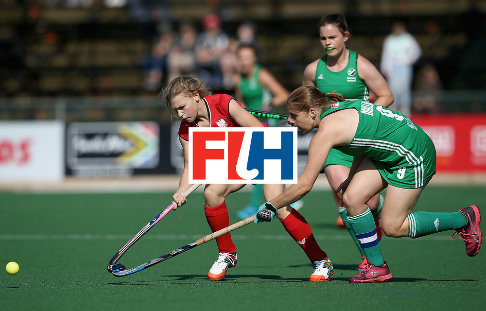 JOHANNESBURG, SOUTH AFRICA - JULY 12: Daria Skoraszewska of Poland and Kathryn Mullan of Ireland for possession during day 3 of the FIH Hockey World League Semi Finals Pool A match between Ireland and Poland at Wits University on July 12, 2017 in Johannesburg, South Africa. (Photo by Jan Kruger/Getty Images for FIH)