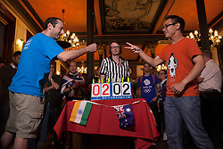 © licensed to London News Pictures. London, UK 08/08/2012. Lapland and Vatican City teams competing against each other in the final match of the UK Rock Paper Scissors Championship at The Knights Templar Pub in central London. Over 100 contestants take part in unique decision making competition. Photo credit: Tolga Akmen/LNP