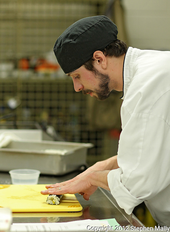 Instructor Daniel Dennis of Cedar Rapids demonstrates how to roll sushi during the Discovering International Foods: Japanese Cuisine class at The Hotel at Kirkwood Center in Cedar Rapids on Wednesday evening, February 15, 2012. (Stephen Mally/Freelance)