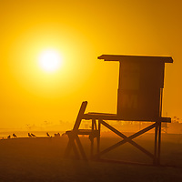 Newport Beach CA lifeguard tower M at sunset photo. Newport Beach is a popular beach city in Orange County Southern California in the Western United States of America. Copyright ⓒ 2017 Paul Velgos with all rights reserved.