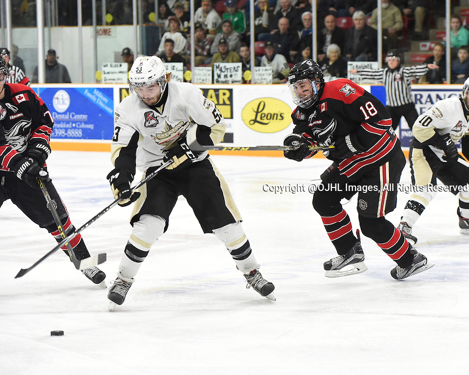 TRENTON, - Apr 15, 2016 -  Ontario Junior Hockey League game action between the against the Trenton Golden Hawks and the Georgetown Raiders. Game 1 of the Buckland Cup Championship Series, at the Duncan Memorial Gardens, ON. Josh Allan #53 of the Trenton Golden Hawks tries to keep the puck from Matthew Thom #18 of the Georgetown Raiders during the second period.<br /> (Photo by Andy Corneau / OJHL Images)