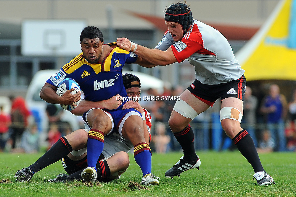 Highlanders Lima Sopoaga is tackled by Crusaders Joe Wheeler and Matt Todd during their Super Rugby Pre-season game Crusaders v Highlanders. Rugby Park, Greymouth, New Zealand. Friday 3 February 2012. Photo: Chris Symes/www.photosport.co.nz