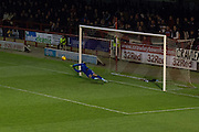Chris Neal Saves Gavin Tomlins penalty during the Sky Bet League 1 match between Crawley Town and Port Vale at Broadfield Stadium, Crawley, England on 20 December 2014. Photo by Stuart Butcher.
