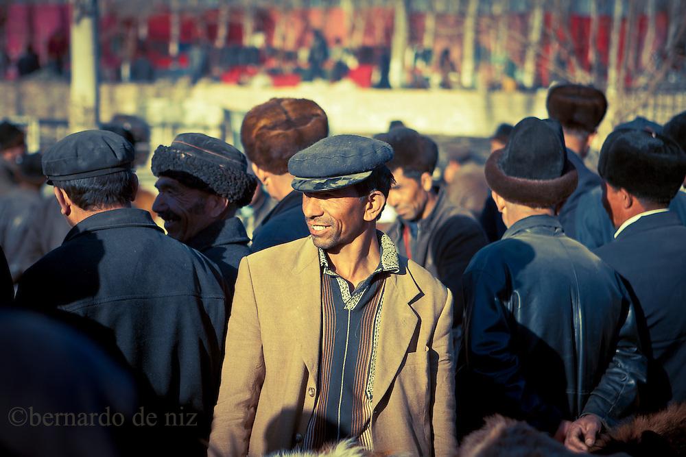 Uyghur man visit the livestock market  in Kashgar, China, February. 21, 2010. Photographer: Bernardo De Niz