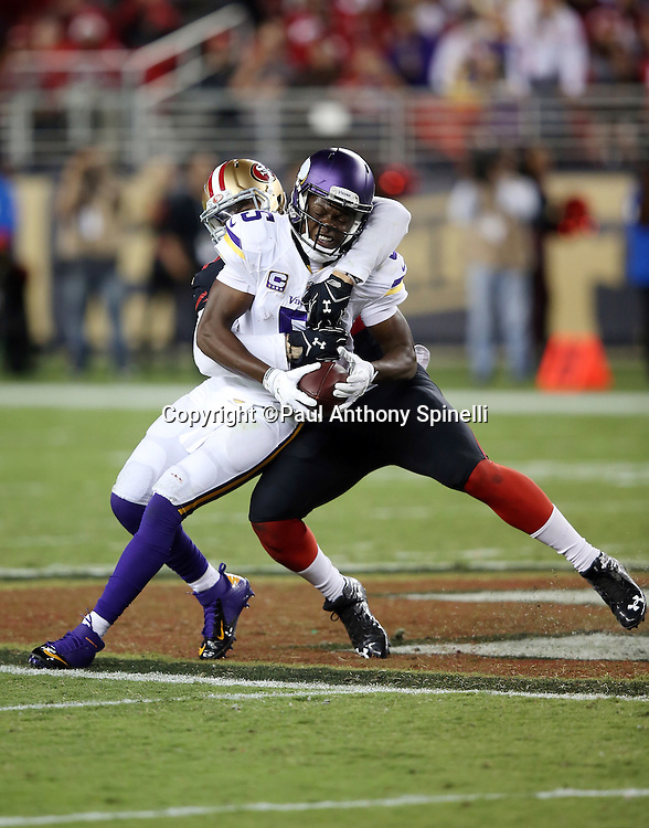 Minnesota Vikings quarterback Teddy Bridgewater (5) gets sacked by San Francisco 49ers outside linebacker Aaron Lynch (59) for a loss of 14 yards  in the fourth quarter during the 2015 NFL week 1 regular season football game against the San Francisco 49ers on Monday, Sept. 14, 2015 in Santa Clara, Calif. The 49ers won the game 20-3. (©Paul Anthony Spinelli)
