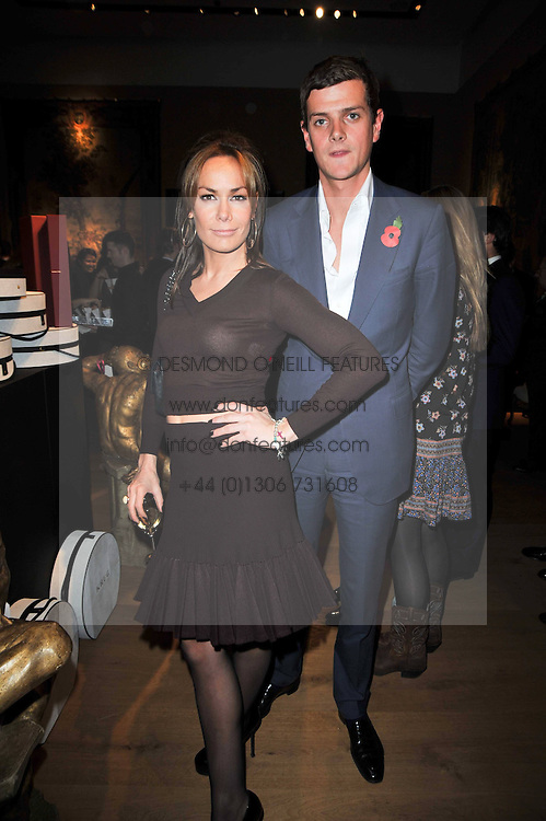 TARA PALMER-TOMKINSON and the HON.ALEXANDER SPENCER-CHURCHILL at the Krug Mindshare Charity Auction held at Christie's, 8 King Street, London SW1 on November 2009.