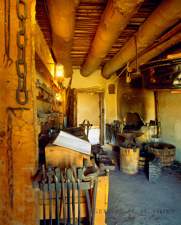 0401-1002 ~ Copyright:  George H. H. Huey ~ Blacksmith's shop, Bent's Fort.  Original frontier fort was built in 1833 as a trading headquarters.  Bent's Old Fort National Historic Site, Colorado.