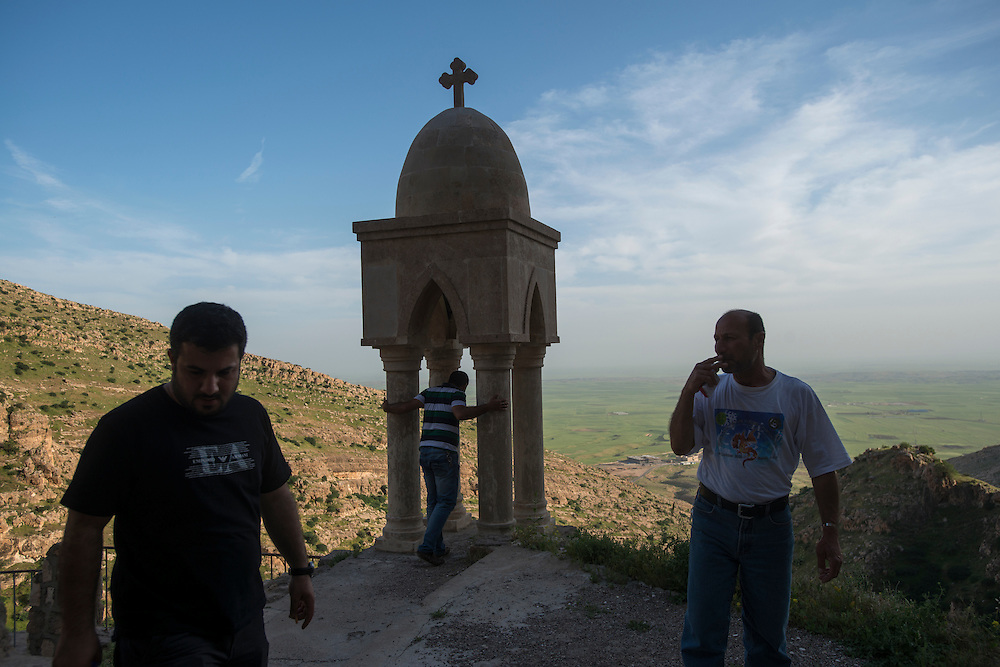A stone cross at the 7th century Rabban Hermizd monastery carved into the mountainside overlooking the Nineveh Plain in Northern Iraq. Christianity came to the area in the first century AD and the Iraqi Christian community is thought to be one of the longest coninuous Christian communities in the world. Violence, persecution and sectarian strife have forced two thirds of Iraqi Christians to flee the country in recent years and many more to be displaced to the relative security of Iraqi Kurdistan. Al Qosh, Iraq. 19/04/2014.