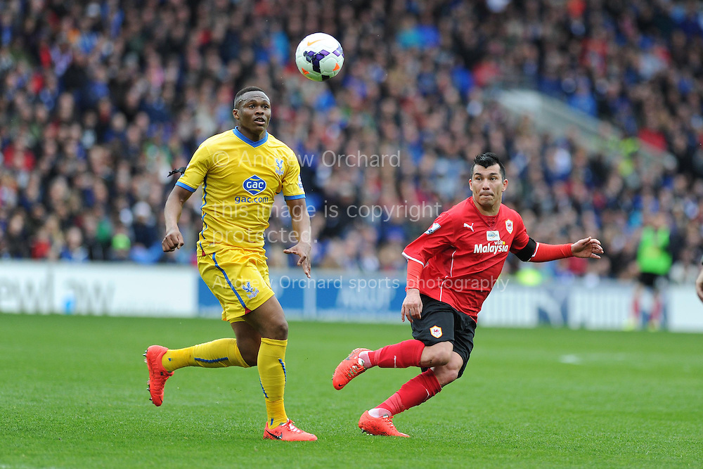 Kagisho Dikgacoi of Crystal Palace (l) is challenged by Cardiff's Gary Medel. Barclays Premier league match, Cardiff city v Crystal Palace at the Cardiff city stadium in Cardiff, South Wales on Saturday 5th April 2014.<br /> pic by Andrew Orchard, Andrew Orchard sports photography.