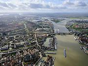 Nederland, Zuid-Holland, Dordrecht, 25-02-2020; Oude Maas, met Spoorbrug Dordrecht(Grote brug) tussen Dordrecht (links) enZwijndrecht. Zicht op havens van Dordrecht, met water van het Malle Gat en de Dordtsche Kil (naar links). Aan de verre horizon het Hollandsch Diep.<br /> Oude Maas (old Meuse), with Railway Bridge Dordrecht between Dordrecht (left) and Zwijndrecht. View of the ports of Dordrecht, river Dordtsche Kil and Hollandsch Diep is on the horizon.<br /> <br /> luchtfoto (toeslag op standard tarieven);<br /> aerial photo (additional fee required)<br /> copyright © 2020 foto/photo Siebe Swart