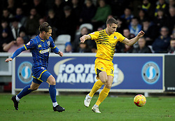 Lee Brown of Bristol Rovers gets away from Dannie Bulman of AFC Wimbledon - Mandatory byline: Robbie Stephenson/JMP - 07966 386802 - 26/12/2015 - FOOTBALL - Kingsmeadow Stadium - Wimbledon, England - AFC Wimbledon v Bristol Rovers - Sky Bet League Two