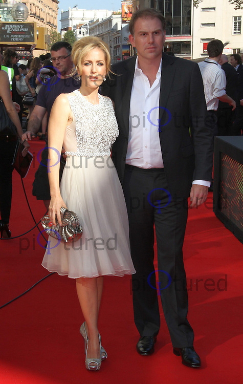 Gillian Anderson; Mark Griffiths Johnny English Reborn UK Premiere, Empire Cinema, Leicester Square, London, UK. 02 October 2011 Contact: Rich@Piqtured.com +44(0)7941 079620 (Picture by Richard Goldschmidt)