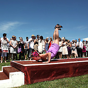 "A lady performs 'The Worm"" during Fashions in the Field during a day at the Races at Ascot Park, Invercargill, Southland, New Zealand. 10th December 2011. Photo Tim Clayton"