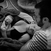 "Parents Carrie and Kevin McGinn admire their new son Cohen moments after he was born in their home in Lynchburg early in the morning on July 12, 2015.  ""It's all about choice.  I am glad I have this option.  If you are most comfortable in a hospital, that is fine.  You need to be comfortable as much as you can in labor,"" said Carrie McGinn.  Photo by Jill Nance"