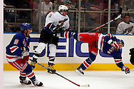 Karel Rachunek of the New York Rangers gets checked by Alex Ovechkin of the  Washington Capitals at Madison Square Garden in New York Thursday 05 October 2006.<br />