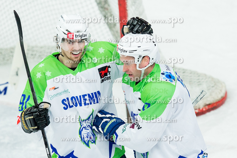 Miha Verlic and Tomaz Razingar of Slovenia celebrate during ice-hockey friendly match between National teams of Slovenia and Japan, on April 10, 2015 in Arena Podmezakla, Jesenice, Slovenia. Photo by Vid Ponikvar / Sportida