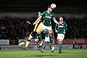 Brentford defender John Egan (14) heads the ball during the EFL Sky Bet Championship match between Burton Albion and Brentford at the Pirelli Stadium, Burton upon Trent, England on 6 March 2018. Picture by Richard Holmes.