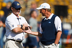 October 9, 2010; Berkeley, CA, USA;  UCLA Bruins head coach Rick Neuheise (right) meets with California Golden Bears head coach Jeff Tedford (left) before the game at Memorial Stadium.