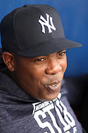 March 18, 2018 - Tampa, FL, U.S. - TAMPA, FL - MAR 18: Aroldis Chapman (54) of the Yankees smiles as he listens in on the conversation during the game between the Miami Marlins and the New York Yankees on March 18, 2018, at George M. Steinbrenner Field in Tampa, FL. (Photo by Cliff Welch/Icon Sportswire) (Credit Image: © Cliff Welch/Icon SMI via ZUMA Press)