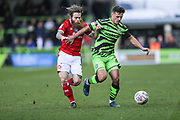 Forest Green Rovers Josh March(28) holds off Walsall's Stuart Sinclair(7) during the EFL Sky Bet League 2 match between Forest Green Rovers and Walsall at the New Lawn, Forest Green, United Kingdom on 8 February 2020.