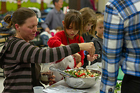 Ray School teachers, parents and students came together Tuesday evening, November 27th, 2018 with direction from Pilot Light chefs to prepare and enjoy Middle Eastern salads as part of the Pilot Light program whose goal is to educate children about healthy food choices. <br /> <br /> 5139 - 5137 - Parent, Chris Wurffel helps Gabriella Ellis and others make a Mediterranean salad.  <br /> <br /> Please 'Like' &quot;Spencer Bibbs Photography&quot; on Facebook.<br /> <br /> Please leave a review for Spencer Bibbs Photography on Yelp.<br /> <br /> Please check me out on Twitter under Spencer Bibbs Photography.<br /> <br /> All rights to this photo are owned by Spencer Bibbs of Spencer Bibbs Photography and may only be used in any way shape or form, whole or in part with written permission by the owner of the photo, Spencer Bibbs.<br /> <br /> For all of your photography needs, please contact Spencer Bibbs at 773-895-4744. I can also be reached in the following ways:<br /> <br /> Website &ndash; www.spbdigitalconcepts.photoshelter.com<br /> <br /> Text - Text &ldquo;Spencer Bibbs&rdquo; to 72727<br /> <br /> Email &ndash; spencerbibbsphotography@yahoo.com<br /> <br /> #SpencerBibbsPhotography <br /> #HydePark <br /> #Community <br /> #Neighborhood<br /> #CanonUSA