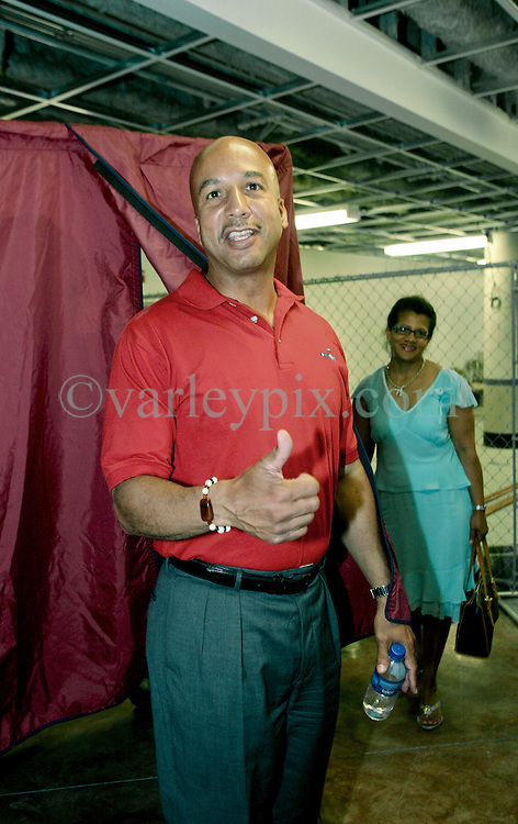 May 20th, 2006. New Orleans, Louisiana. Mayor Ray Nagin and his wife Seletha (in blue) and 7 year old daughterTianna (in yellow) arrive at  the polls in what is likely to be a closely fought race for the Mayor of New Orleans. The Mayor and his family arrive at Jesuit High School to cast their ballots in the historic Mayoral race.<br /> Photo; Charlie Varley/varleypix.com