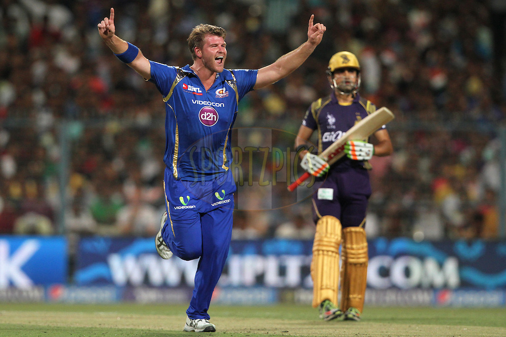 Corey Anderson of the Mumbai Indians celebrates the wicket of Robin Uthappa of the Kolkata Knight Riders during match 1 of the Pepsi IPL 2015 (Indian Premier League) between The Kolkata Knight Riders and The Mumbai Indians held at Eden Gardens Stadium in Kolkata, India on the 8th April 2015.<br /> <br /> Photo by:  Deepak Malik / SPORTZPICS / IPL