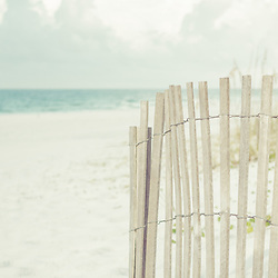 Panorama photo of a beach fence on Casino Beach in Pensacola Beach Florida. Pensacola Beach is a coastal city in the Emerald Coast area of the Southeastern United States. Panoramic photo ratio is 1:3. Copyright ⓒ 2018 Paul Velgos with All Rights Reserved.