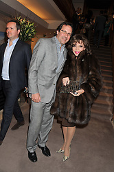 JOAN COLLINS and PERCY GIBSON at the Lighthouse Gala Auction in aid of The Terrence Higgins Trust held at Christie's, 8 King Street, St.James' London on 19th March 2012.