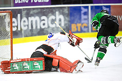 19.10.2013, Hala Tivoli, Ljubljana, SLO, EBEL, AUT, EBEL, HDD Telemach Olimpija Ljubljana vs HC TWK Innsbruck, 24. Runde, im Bild Matej Hocevar (HDD Telemach Olimpija, #14) scores againth Adam Munro (HC TWK Innsbruck Die Haie, #51) // during the Erthe Bank Icehockey League 24 th round match between HDD Telemach Olimpija Ljubljana and HC TWK Innsbruck Hala Tivoli in Ljubljana, Slovenia on 2013/10/19. EXPA Pictures © 2013, PhotoCredit: EXPA/ Sportida/ Matic Klansek Velej<br /> <br /> *****ATTENTION - OUT of SLO*****