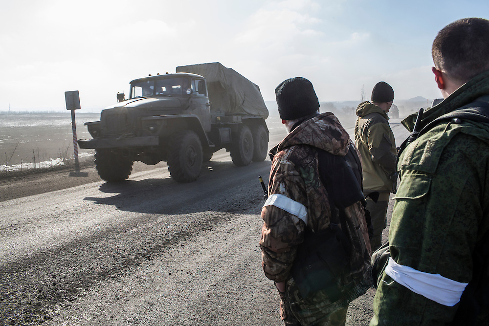 ZORYNSK, UKRAINE - FEBRUARY 20: Military trucks drive away from the town of Debaltseve on February 20, 2015 in Zorynsk, Ukraine. Ukrainian forces withdrew from the strategic and hard-fought town after being effectively surrounded by pro-Russian rebels, though fighting has caused widespread destruction. (Photo by Brendan Hoffman/Getty Images) *** Local Caption ***