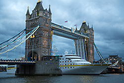 © Licensed to London News Pictures. 08/05/2014. London's 2014 cruise ship season has got under way with the arrival of MV HAMBURG last night (7th April). The 144-metre long vessel, operated by Plantours Kreuzfahrten, is the first cruise visitor to the capital of the year. She passed landmarks such as the Dartford Bridge, Thames Barrier and Tower Bridge as she made her way up to a mooring in the Upper Pool of London under a cloudy sky. Credit : Rob Powell/LNP