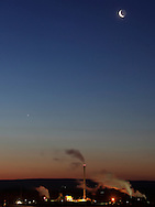 Town of Wallkill, New York - The crescent moon and Venus in the sky above factories before dawn on March 30, 2011.