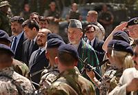 11 AUG 2003, KABUL/AFGANISTAN:<br /> Sayed Karsai Karsai (M mit Hut) Praesident Afganistan, auf dem Weg zum Appell zur Uebergabe der Fuehrung der International Security Assistance Force, ISAF, von Deutschland und den Niederlanden an die NATO, Armani Schule<br /> IMAGE: 20030811-01-022<br /> KEYWORDS: Bundeswehr, Streitkraefte, Streitkräfte,   Bundeswehr