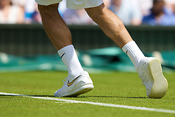 LONDON, ENGLAND - Monday, June 23, 2008: The white Nike shoes of Roger Federer (SUI) in action during his first round match on day one of the Wimbledon Lawn Tennis Championships at the All England Lawn Tennis and Croquet Club. (Photo by David Rawcliffe/Propaganda)