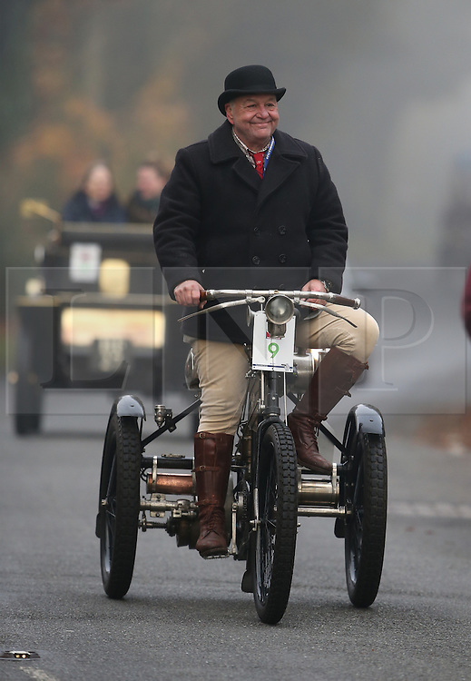 © Licensed to London News Pictures. 01/11/2015. Staplefield, UK. A 1898 De Dion Bouton Tricyle motors through Staplefield during the London to Brighton Veteran Car Run.  Photo credit: Peter Macdiarmid/LNP