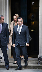 © Licensed to London News Pictures. 14/10/2016. London, UK. Nissan Chairman and CEO Carlos Ghosn leaves Downing Street after holding talks with Prime Minister Theresa May. Mr Ghosn has stated that he would like a government pledge to  compensate Nissan for any tariffs that may be imposed after the UK leaves the EU. Photo credit: Peter Macdiarmid/LNP