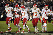 The Kansas City Chiefs offense walks toward the line of scrimmage during the NFL week 12 regular season football game against the Oakland Raiders on Thursday, Nov. 20, 2014 in Oakland, Calif. The Raiders won their first game of the season 24-20. ©Paul Anthony Spinelli