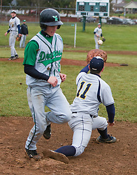 WMHS senior Bruce Shifflett (5) beats the throw to first to reach on an infield hit.  The Fluvana County High School baseball team faced William Monroe HS at WMHS in Stanardsville, VA on April 15, 2009.  (Special to the Daily Progress / Jason O. Watson)