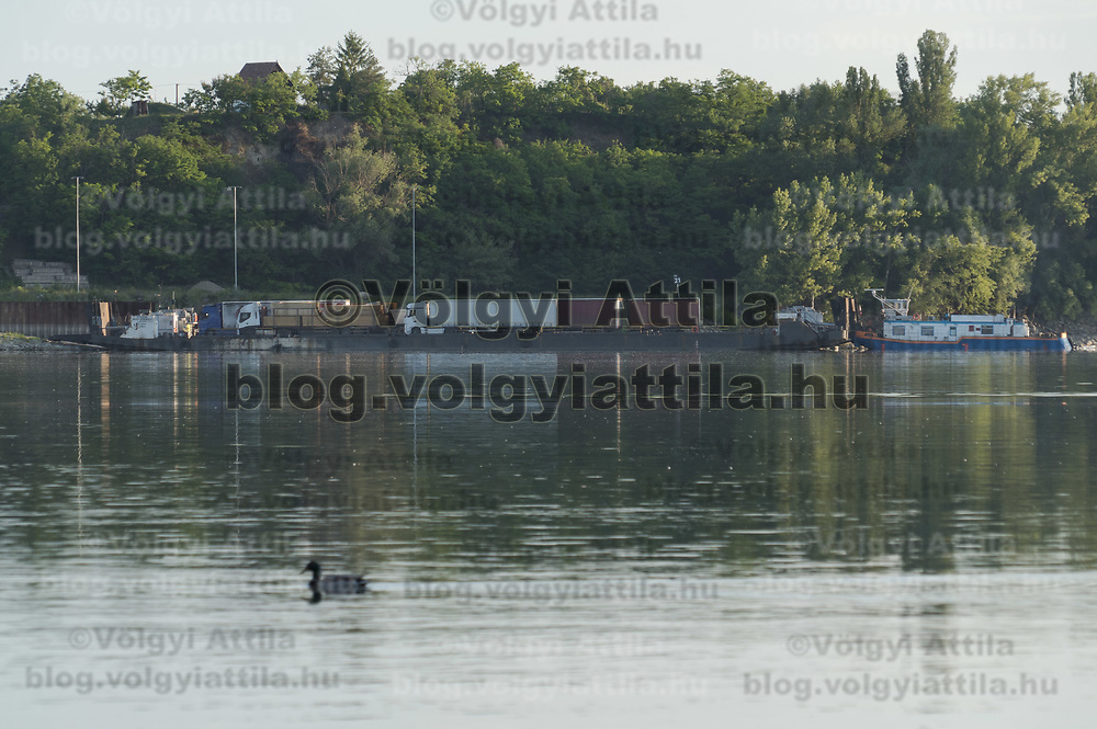 Cargo ferry is seen transporting tucks across river Danube on the border between Slovakia and Hungary in Esztergom, Hungary on June 4, 2020. ATTILA VOLGYI