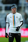 Sean Longstaff (#36) of Newcastle United warms up ahead of the Premier League match between Newcastle United and Southampton at St. James's Park, Newcastle, England on 8 December 2019.