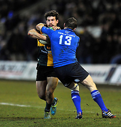 Dominic Waldouck (Northampton) is tackled high by Brian O'Driscoll (Leinster) - Photo mandatory by-line: Patrick Khachfe/JMP - Tel: Mobile: 07966 386802 07/12/2013 - SPORT - RUGBY UNION -  Franklin's Gardens, Northampton - Northampton Saints v Leinster - Heineken Cup.