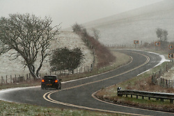 © Licensed to London News Pictures. 28/01/2020. Llanfihangel-nant-Melan, Powys, Wales, UK. Motorists negotiate hazardous conditions on the A44 near the small Welsh village of Llanfihangel-nant-Melan in Powys, Wales, UK. Photo credit: Graham M. Lawrence/LNP