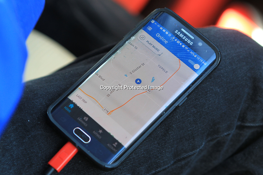 Carlos Diaz, a driver for UBER, keeps the map up on his phone in case a call comes in on the UBER App for a passenger pick up.