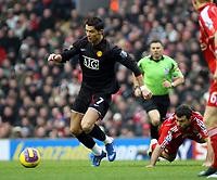 Photo: Mark Stephenson/Sportsbeat Images.<br /> Liverpool v Manchester United. The FA Barclays Premiership. 16/12/2007.Cristiano Ronaldo gets past Liverpool's Javier Mascherano