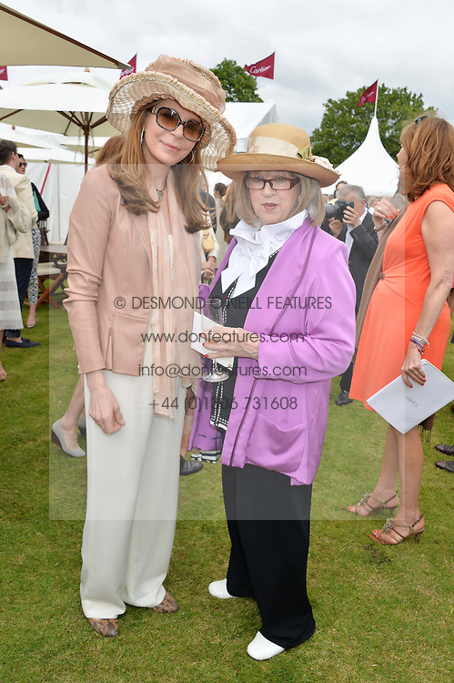 Left to right, QUEEN NOOR OF JORDAN and TESSA KENNEDY at the Cartier Queen's Cup Final polo held at Guards Polo Club, Smith's Lawn, Windsor Great Park, Egham, Surrey on 15th June 2014.