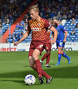 Stephen Darby looks to tear the defence open with a cross during the Sky Bet League 1 match between Oldham Athletic and Bradford City at Boundary Park, Oldham, England on 5 September 2015. Photo by Mark Pollitt.