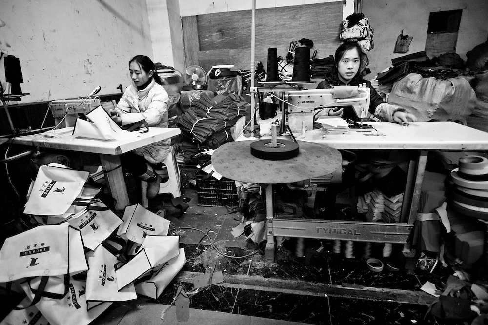 CHONGQING, CHINA - DECEMBER 31, 2010:  workers in a textile factory